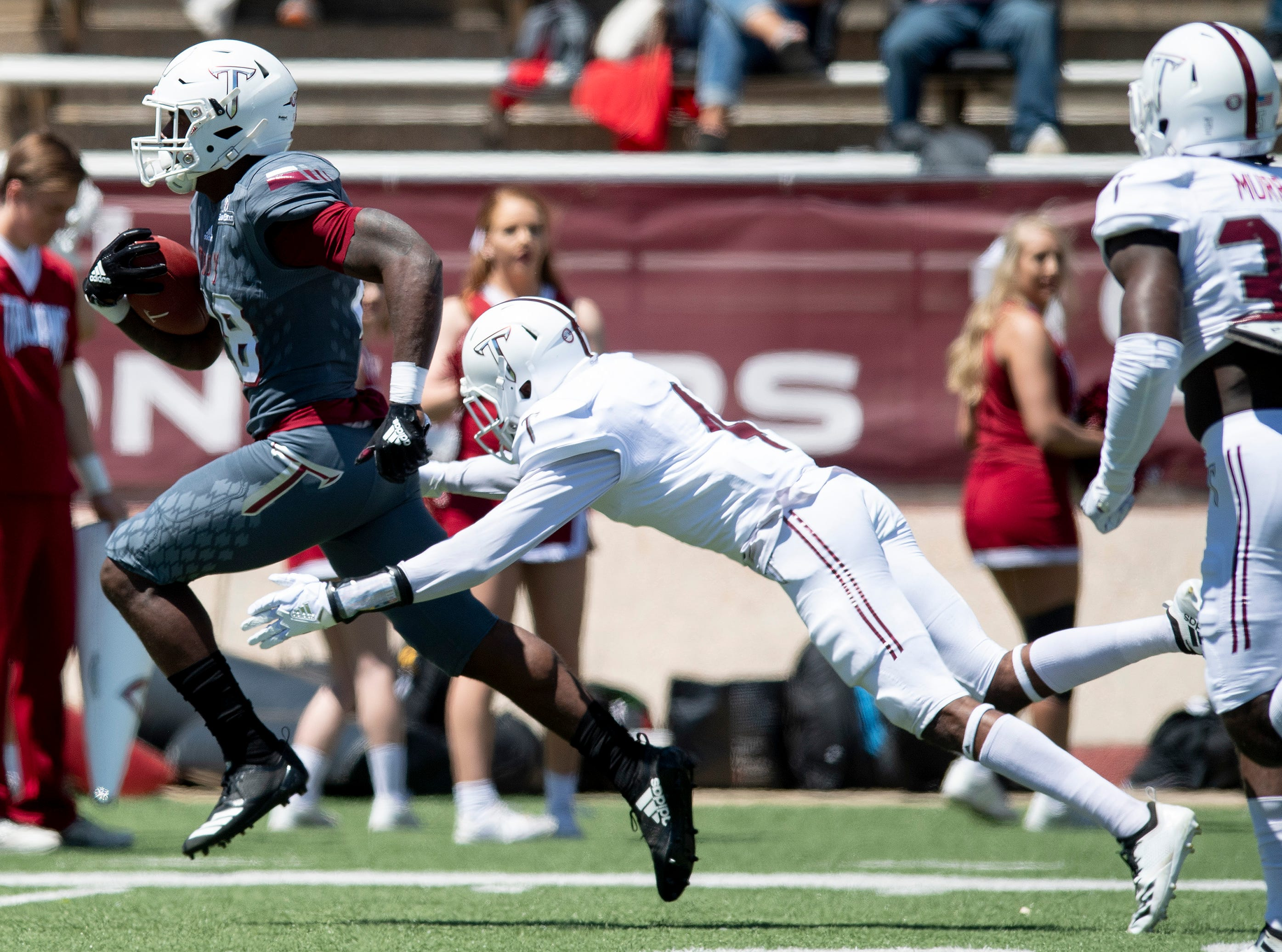 Troy running back Charles Strong (28) gets by safety Koby Perry (4) for a touchdown during the Troy University T-Day spring scrimmage game in Troy, Ala., on Saturday April 20, 2019.