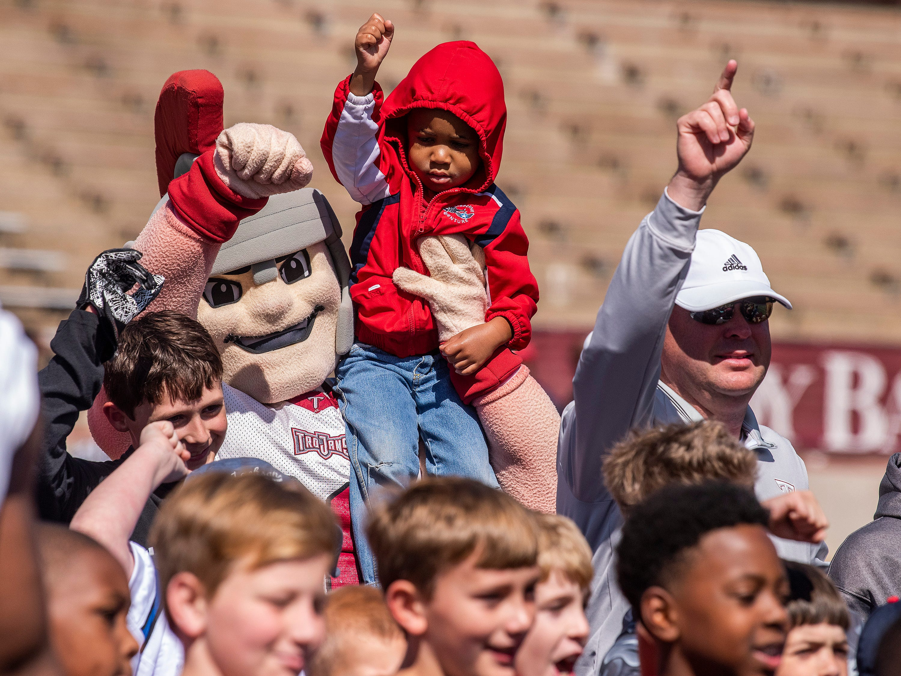 Troy mascot T-Roy and Troy head football coach Chip Lindsey pose with children during a football clinic before the Troy University T-Day spring scrimmage game in Troy, Ala., on Saturday April 20, 2019.