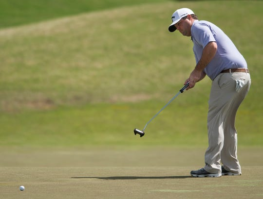 Jonathan Randolph putts on the seventh hole during the third round of the Robert Trent Jones Championship at the Capitol Hill Golf Course in Prattville, Ala., on Saturday, April 20, 2019.