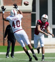 Troy defensive tackle Antione Barker (40) defends against the pass Quarterback Gunnar Watson (18) during the Troy University T-Day spring scrimmage game in Troy, Ala., on Saturday April 20, 2019.