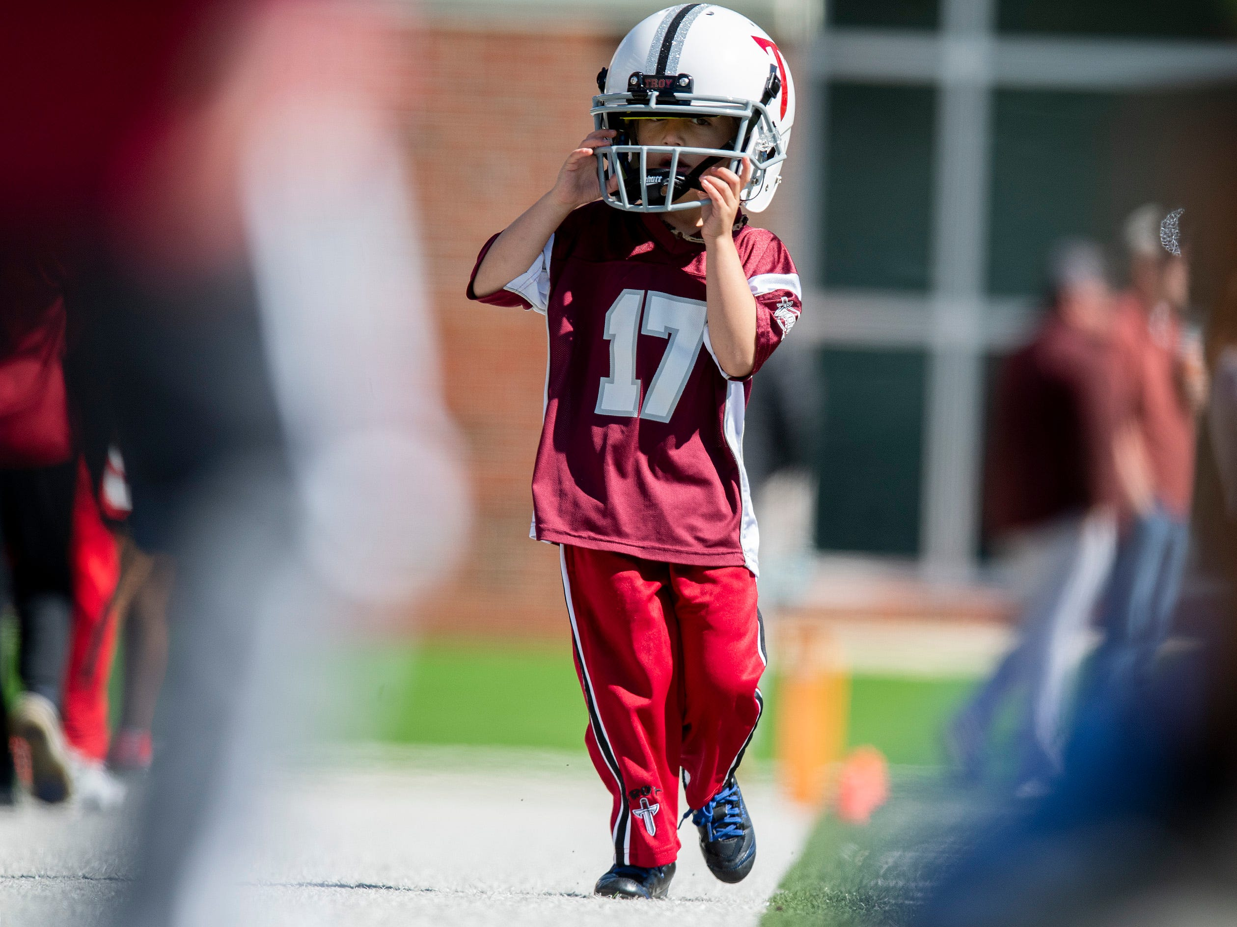 Children take part in a football clinic before the Troy University T-Day spring scrimmage game in Troy, Ala., on Saturday April 20, 2019.