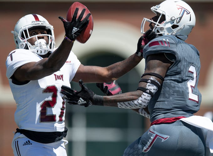 Troy defender Kevin Nixon (21) breaks up a pass intended for Troy wide receiver Reggie Todd (2) during the Troy University T-Day spring scrimmage game in Troy, Ala., on Saturday April 20, 2019.