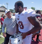Troy head coach Chip Lindsey chats with defensive tackle Marcus Webb (48) following the Troy University T-Day spring scrimmage game in Troy, Ala., on Saturday April 20, 2019.