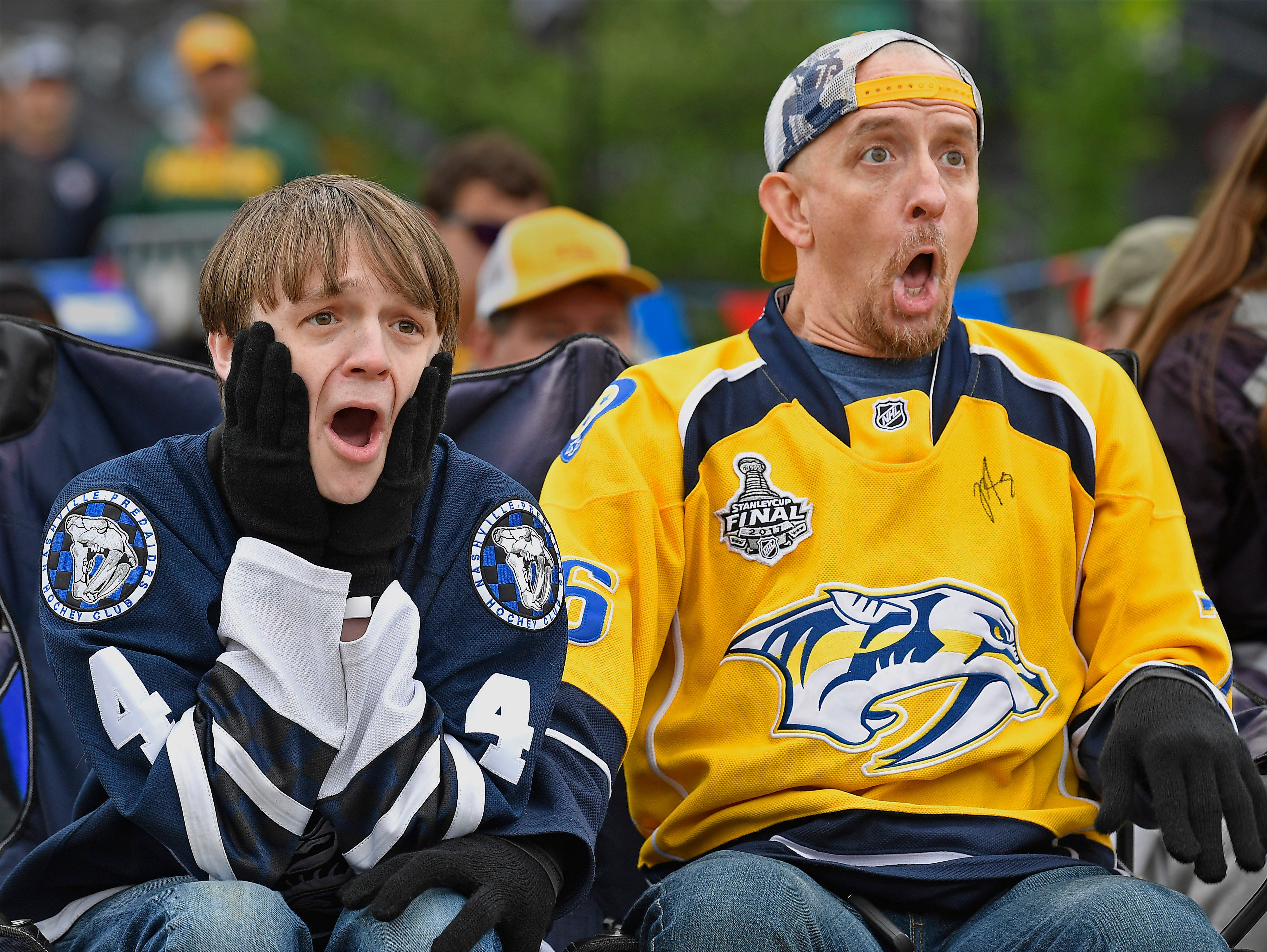 Riley Campbell and his father Jonathan gasp as the Stars score a goal in the first period during the watch party of the divisional semifinal game at Bridgestone Arena Saturday, April 20, 2019, in Nashville, Tenn.