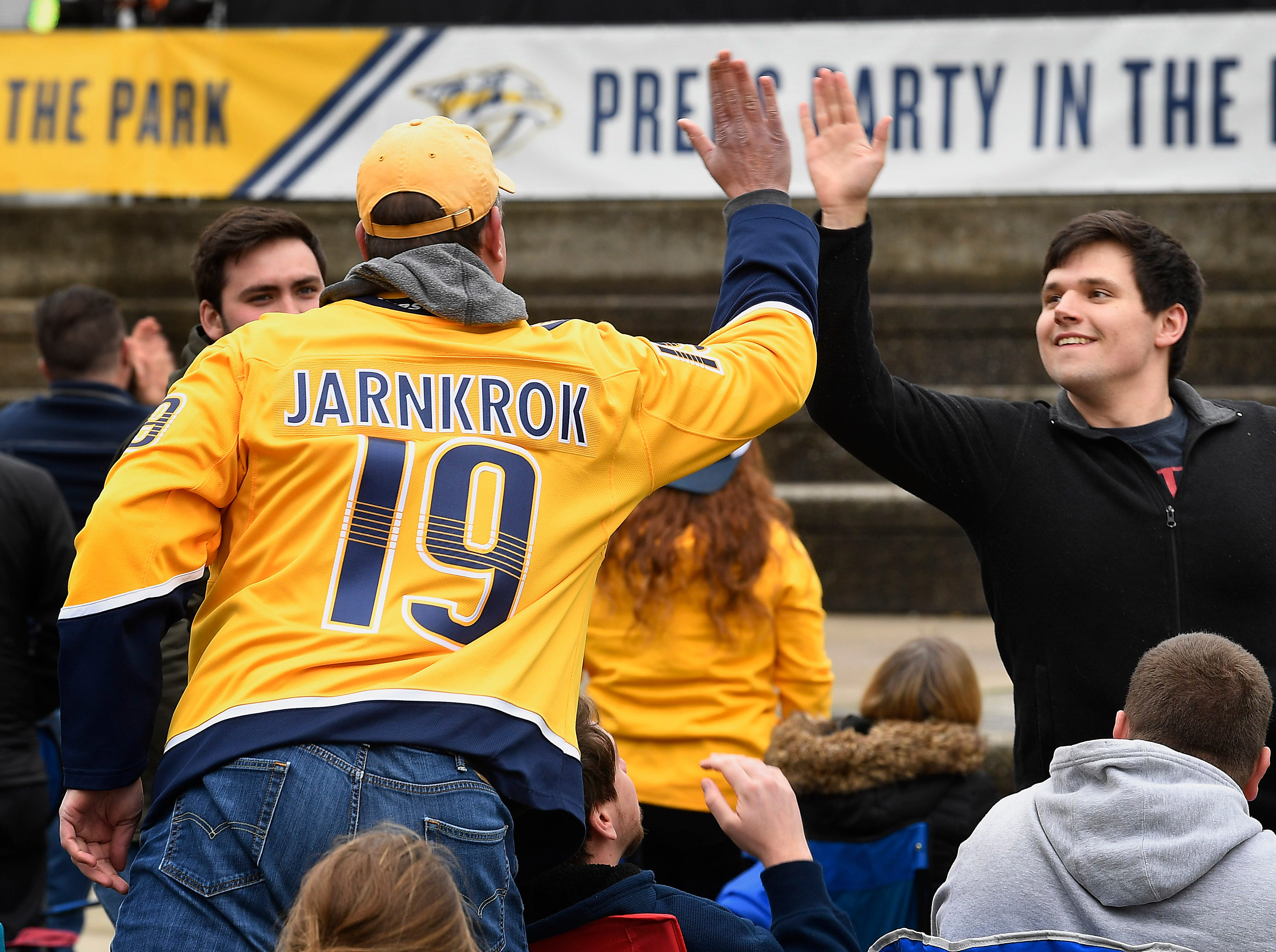 Kurt Oberstealf and Mark England high five after the Predators score in the first period during the watch party of the divisional semifinal game against the Stars at Bridgestone ArenaSaturday, April 20, 2019, in Nashville, Tenn.