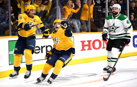 Nashville Predators center Rocco Grimaldi (23) celebrates his goal with defenseman Roman Josi (59) as Dallas Stars defenseman Roman Polak (45) reacts during the first period of the divisional semifinal game at Bridgestone Arena in Nashville, Tenn., Saturday, April 20, 2019.