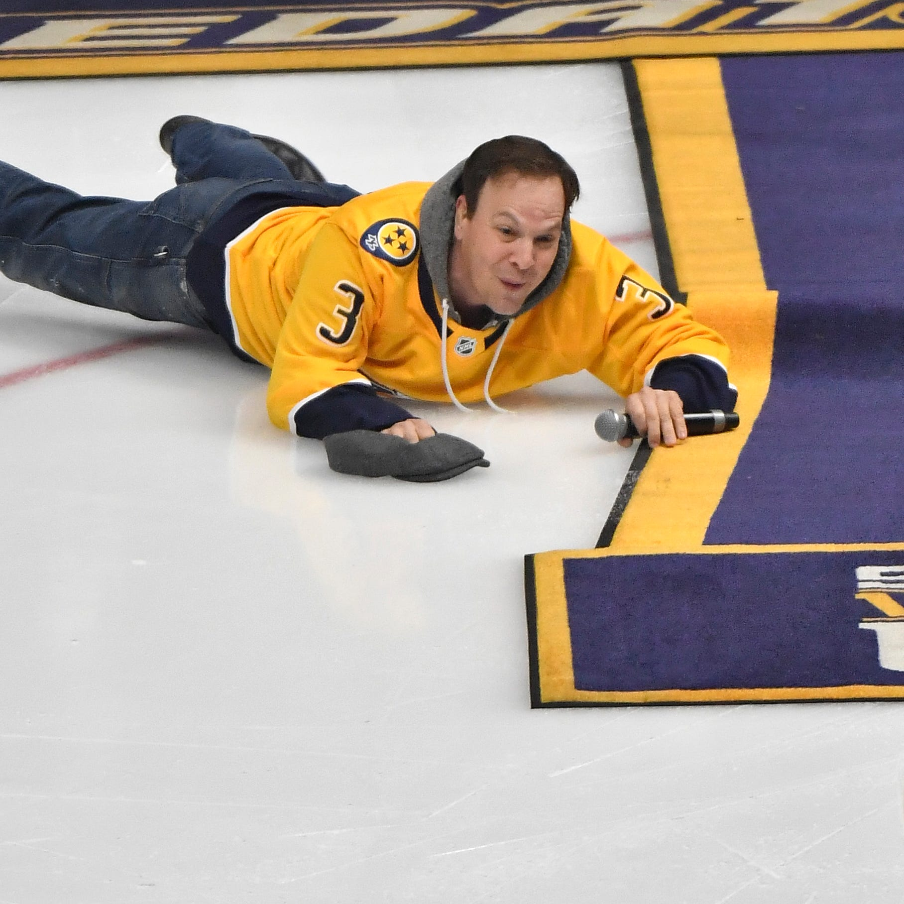 "Oops: Gavin deGraw face plants after national anthem before game 5 between predators and stars ""class ="" more-section-stories-thumb"