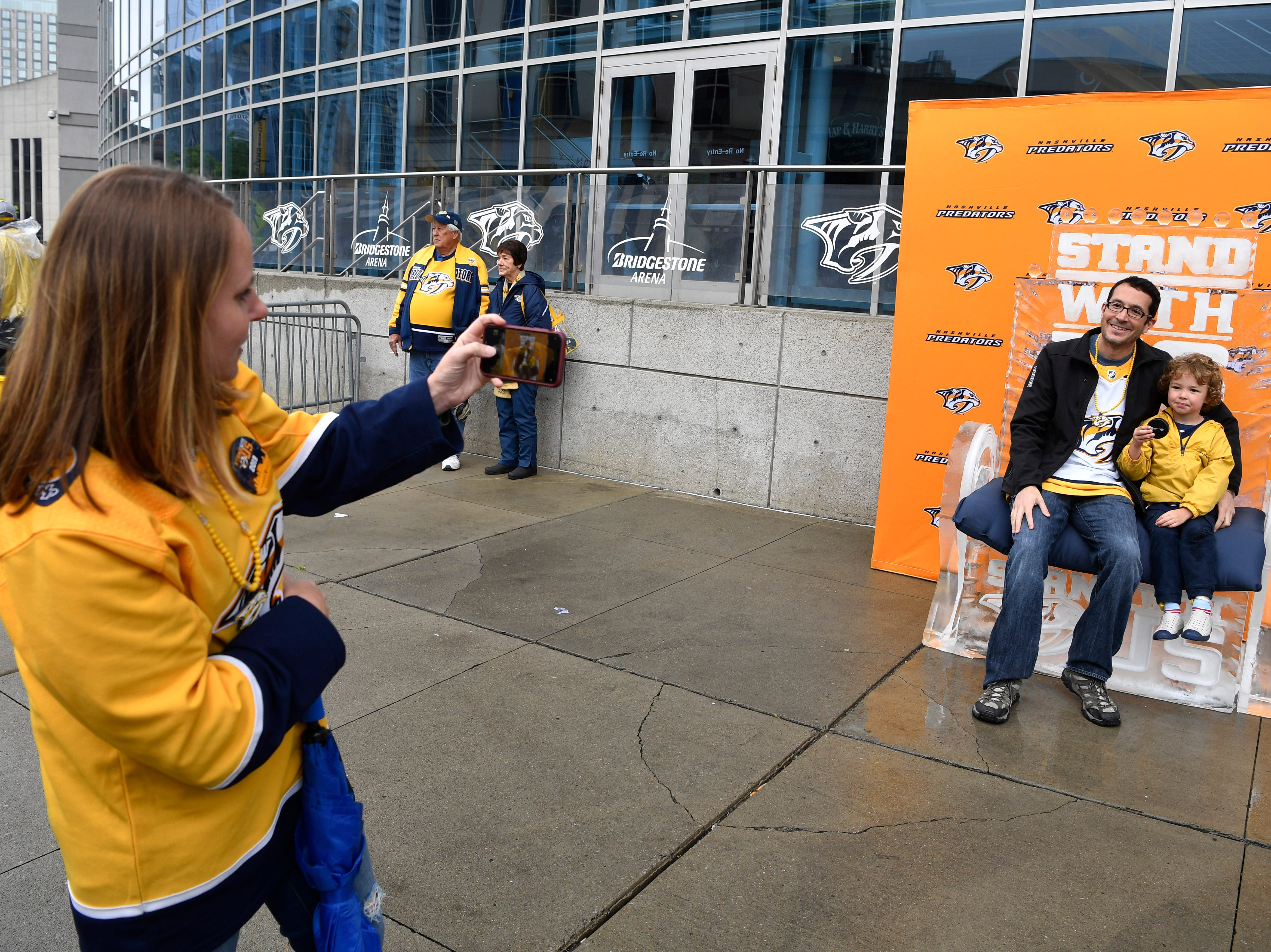 Allison Maltby takes a photo of her husband Alan Neely and son Alex before the divisional semifinal game against the Stars at Bridgestone Arena Saturday, April 20, 2019, in Nashville, Tenn.