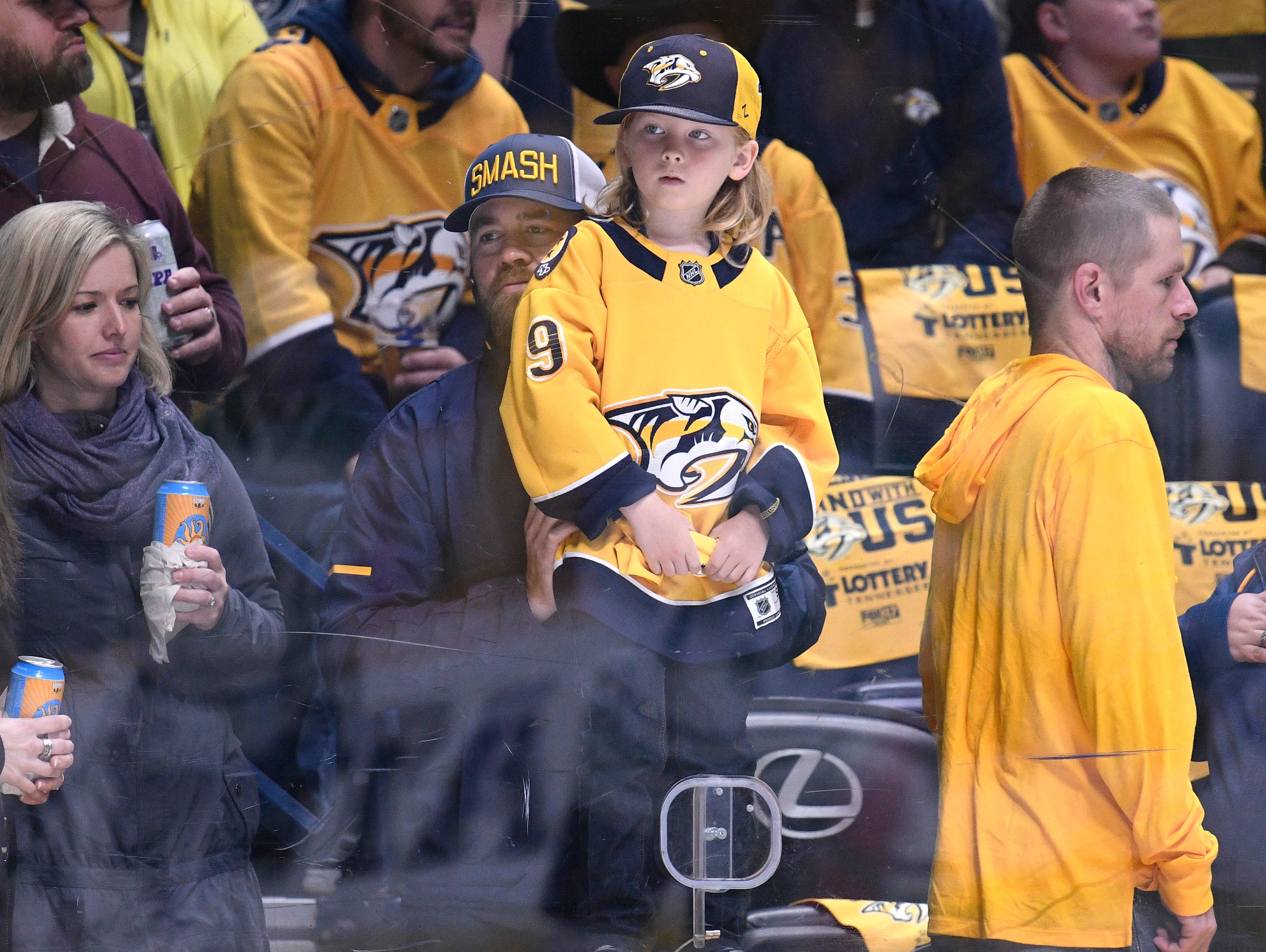 A young Predators fan watches warmups before the divisional semifinal game against the Stars at Bridgestone Arena in Nashville, Tenn., Saturday, April 20, 2019.