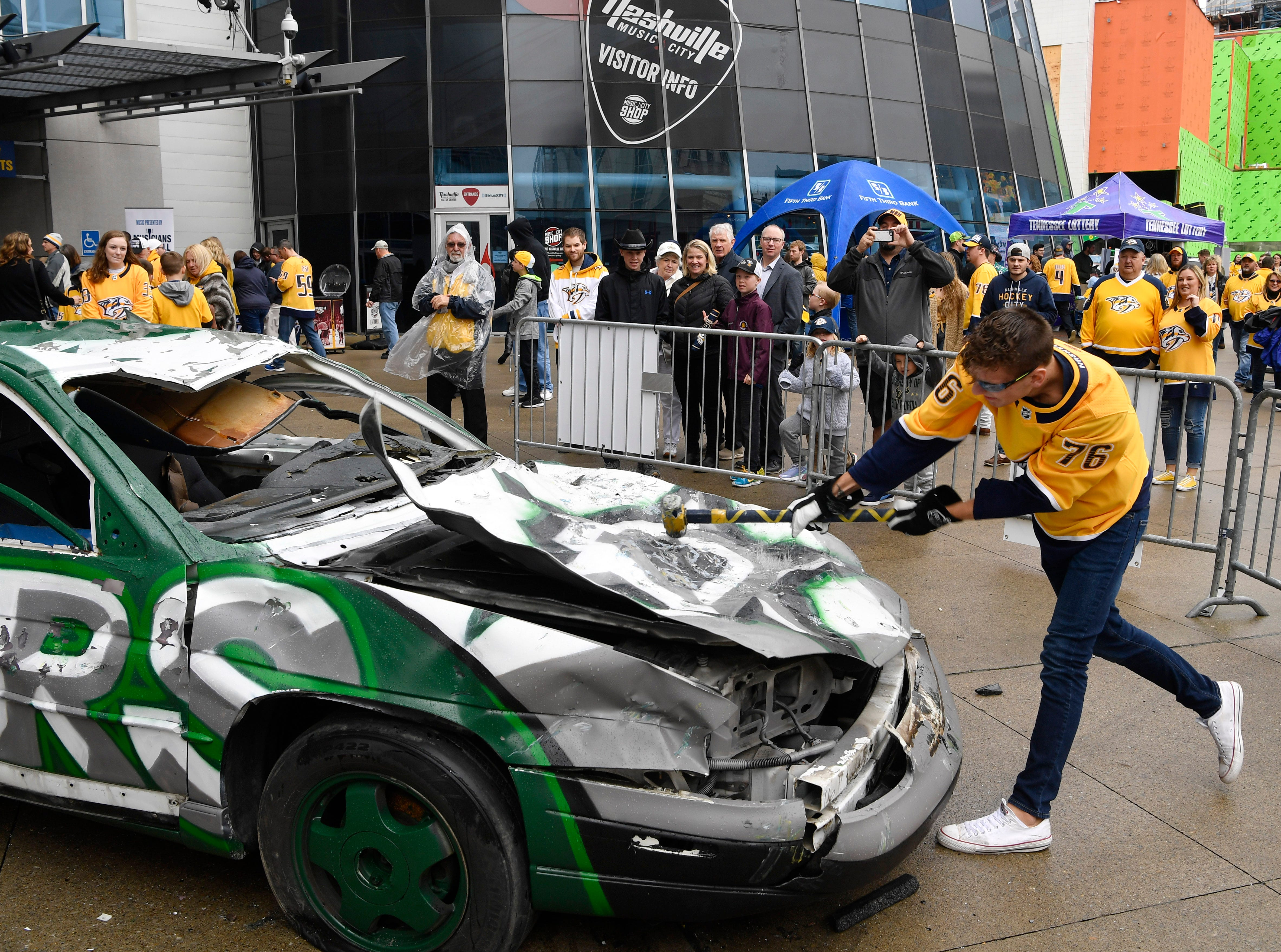 Tyler Murcko takes a swing at the Smash Car before the divisional semifinal game against the Stars at Bridgestone Arena Saturday, April 20, 2019, in Nashville, Tenn.