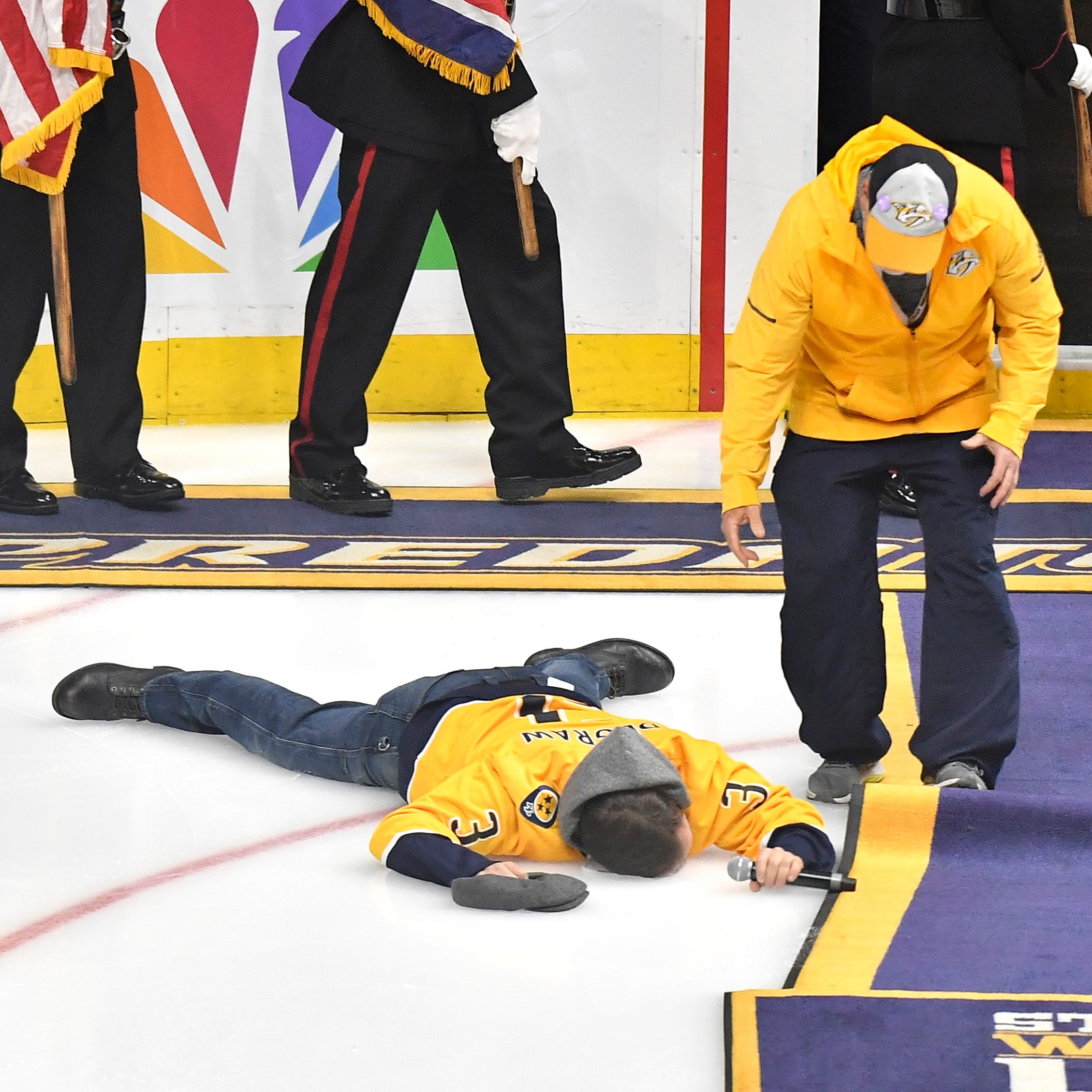 Three views of Gavin DeGraw's face plant after Predators national anthem
