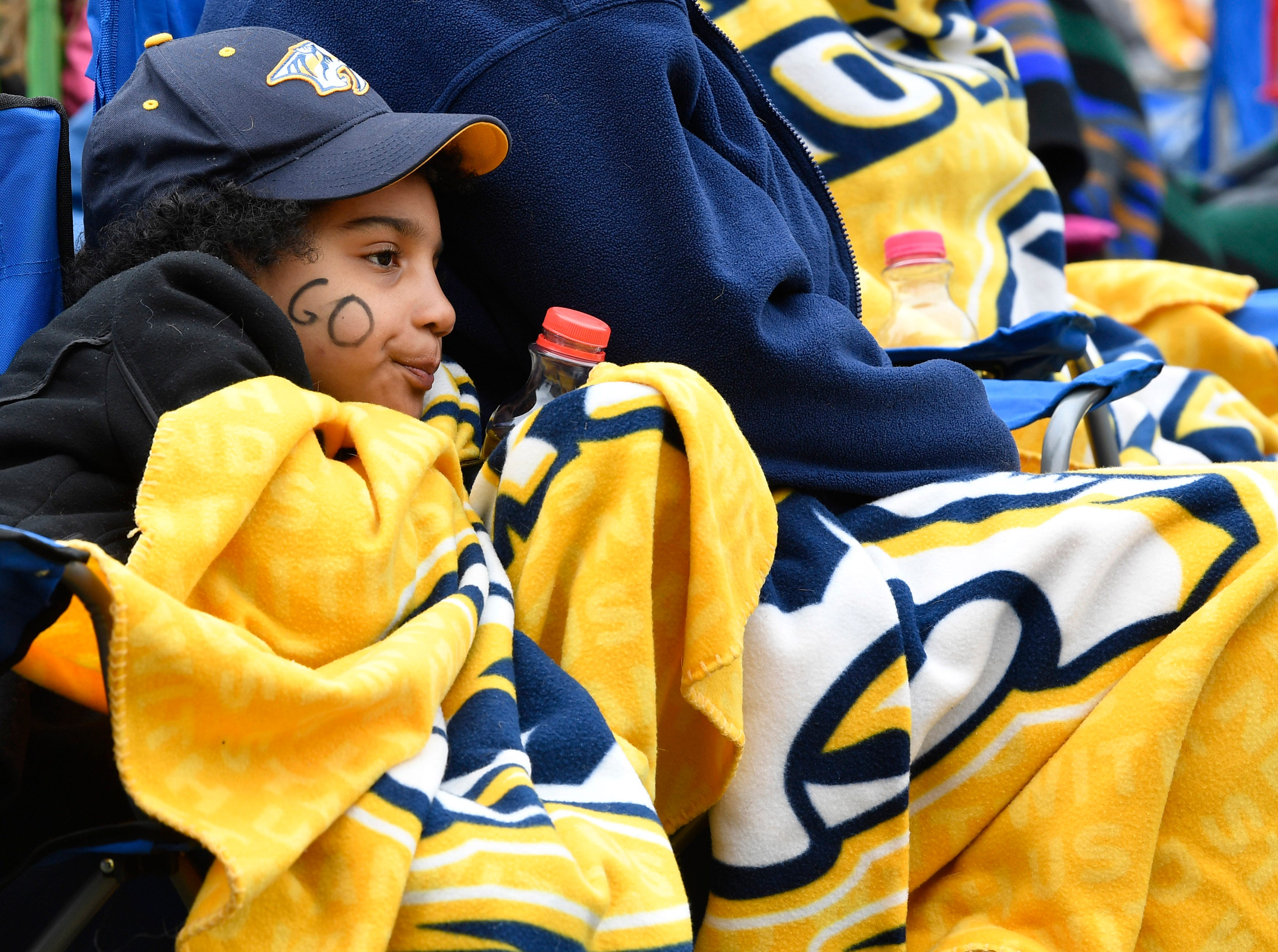 Robyn Patterson tries to stay warm in the chilly weather during the watch party of the divisional semifinal game against the Stars at Bridgestone ArenaSaturday, April 20, 2019, in Nashville, Tenn.