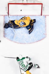 Dallas Stars center Jason Dickinson (16) scores a goal past Nashville Predators goaltender Pekka Rinne (35) during the first period of the divisional semifinal game at Bridgestone Arena in Nashville, Tenn., Saturday, April 20, 2019.
