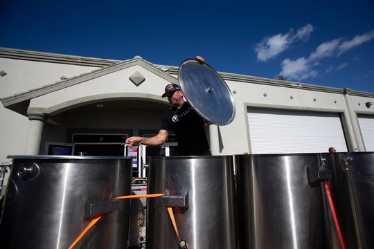 Momentum Brewhouse co-founder Brian Hahn secures brewing equipment on a trailer bed, Saturday, April 20, 2019, at Momentum Brewhouse in Bonita Springs.