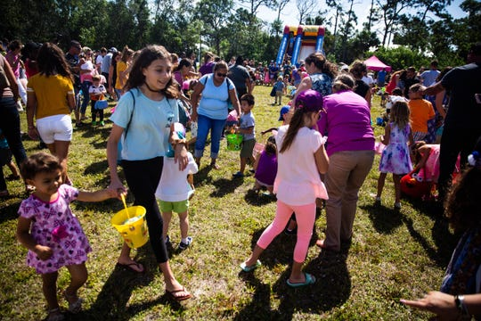 Children hunt for eggs at the 25th annual Royal Scoop Easter Egg Hunt at New Life Church in Bonita Springs on Saturday, April 20, 2019. This will be the last egg hunt at the venue.