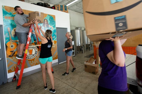 Todd Fischer, lends a hand with a moving project, Saturday, April 20, 2019, at Momentum Brewhouse in Bonita Springs.