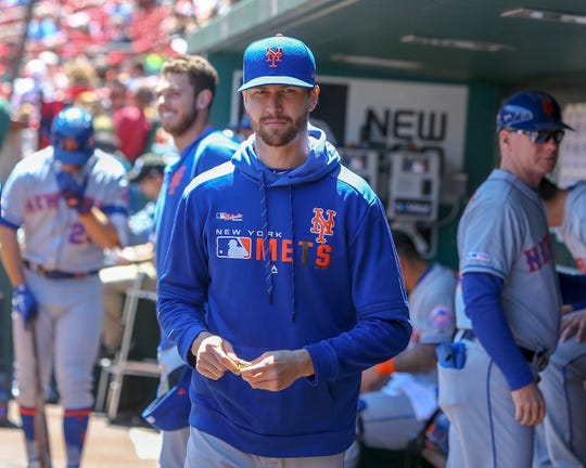 New York Mets' Jacob deGrom stands in the dugout prior to a baseball game against the St. Louis Cardinals, Saturday, April 20, 2019, in St. Louis.