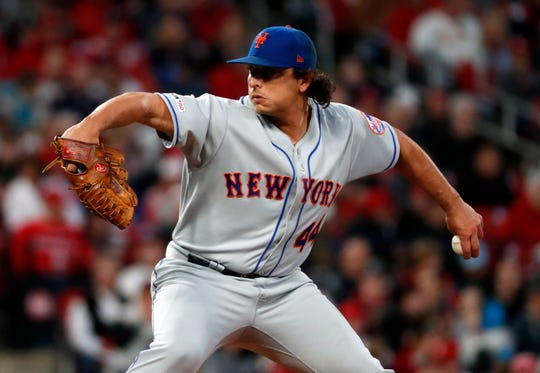 New York Mets starting pitcher Jason Vargas throws during the first inning of the team's baseball game against the St. Louis Cardinals on Friday, April 19, 2019, in St. Louis.