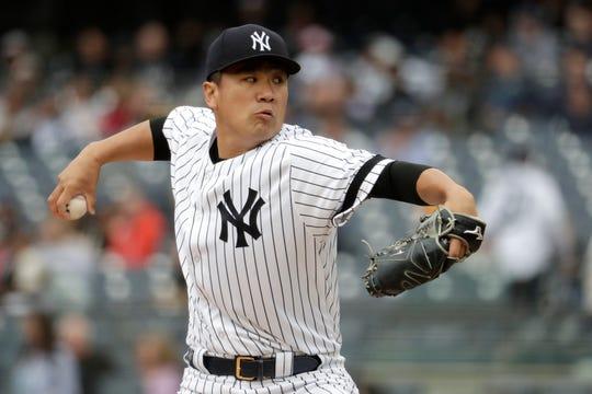 New York Yankees starting pitcher Masahiro Tanaka throws a pitch to Kansas City Royals' Adalberto Mondesi during the first inning of a baseball game, Saturday, April 20, 2019, in New York.