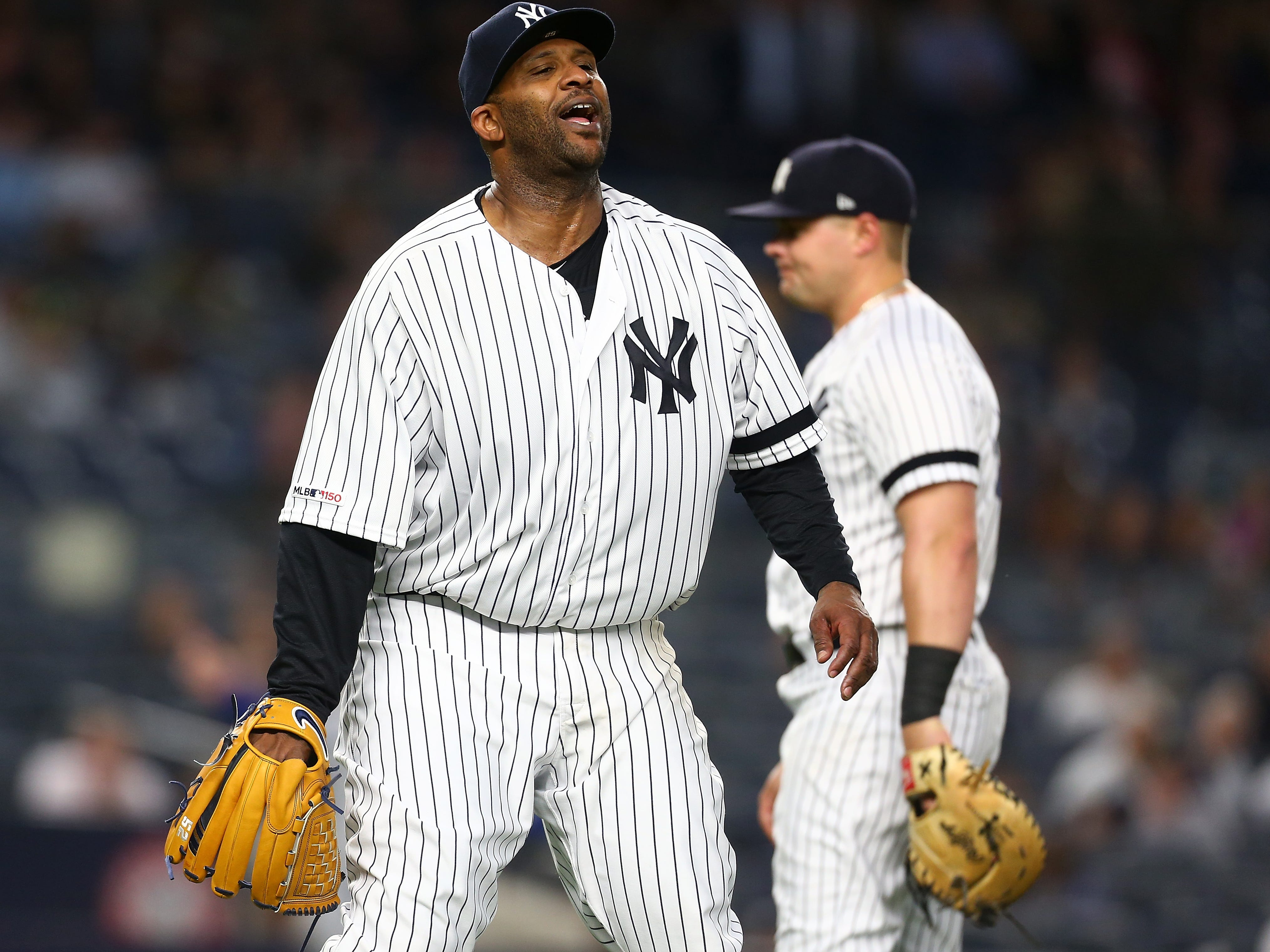 CC Sabathia of the New York Yankees reacts after committing a error in the third inning againt the Kansas City Royals at Yankee Stadium on April 19, 2019 in New York City.
