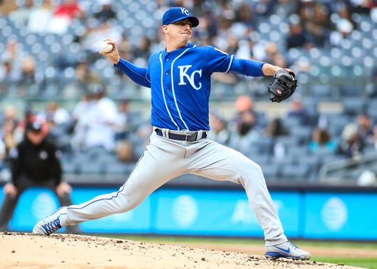 Apr 20, 2019; Bronx, NY, USA; Kansas City Royals pitcher Heath Fillmyer (49) pitches in the first inning against the New York Yankees at Yankee Stadium.