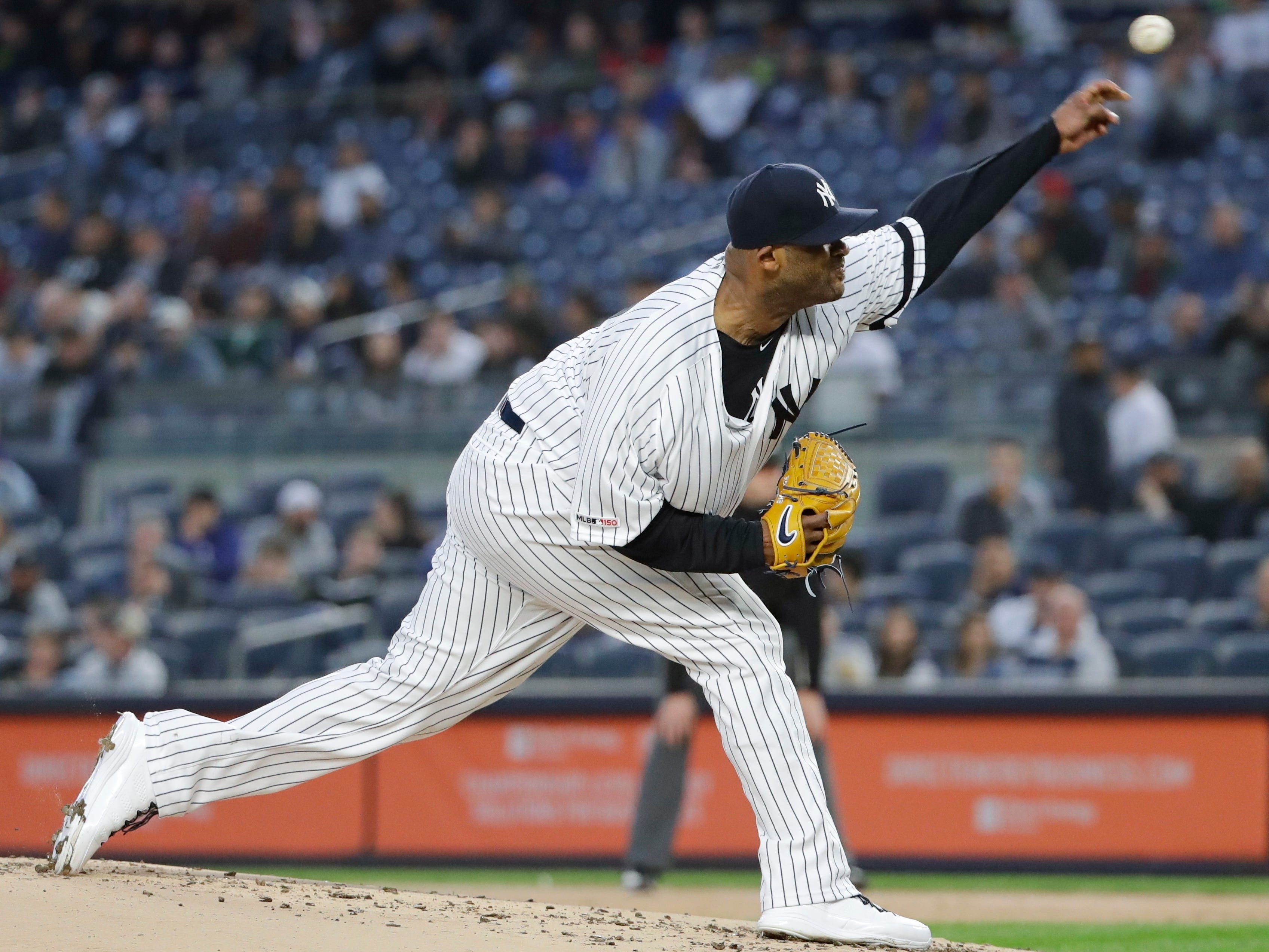 New York Yankees' CC Sabathia delivers a pitch during the first inning of a game against the Kansas City Royals, Friday, April 19, 2019, in New York.