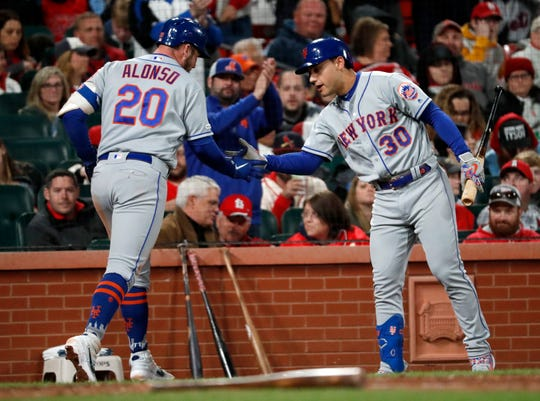 New York Mets' Pete Alonso (20) is congratulated by Michael Conforto (30) after hitting a solo home run during the sixth inning of a baseball game against the St. Louis Cardinals on Friday, April 19, 2019, in St. Louis.