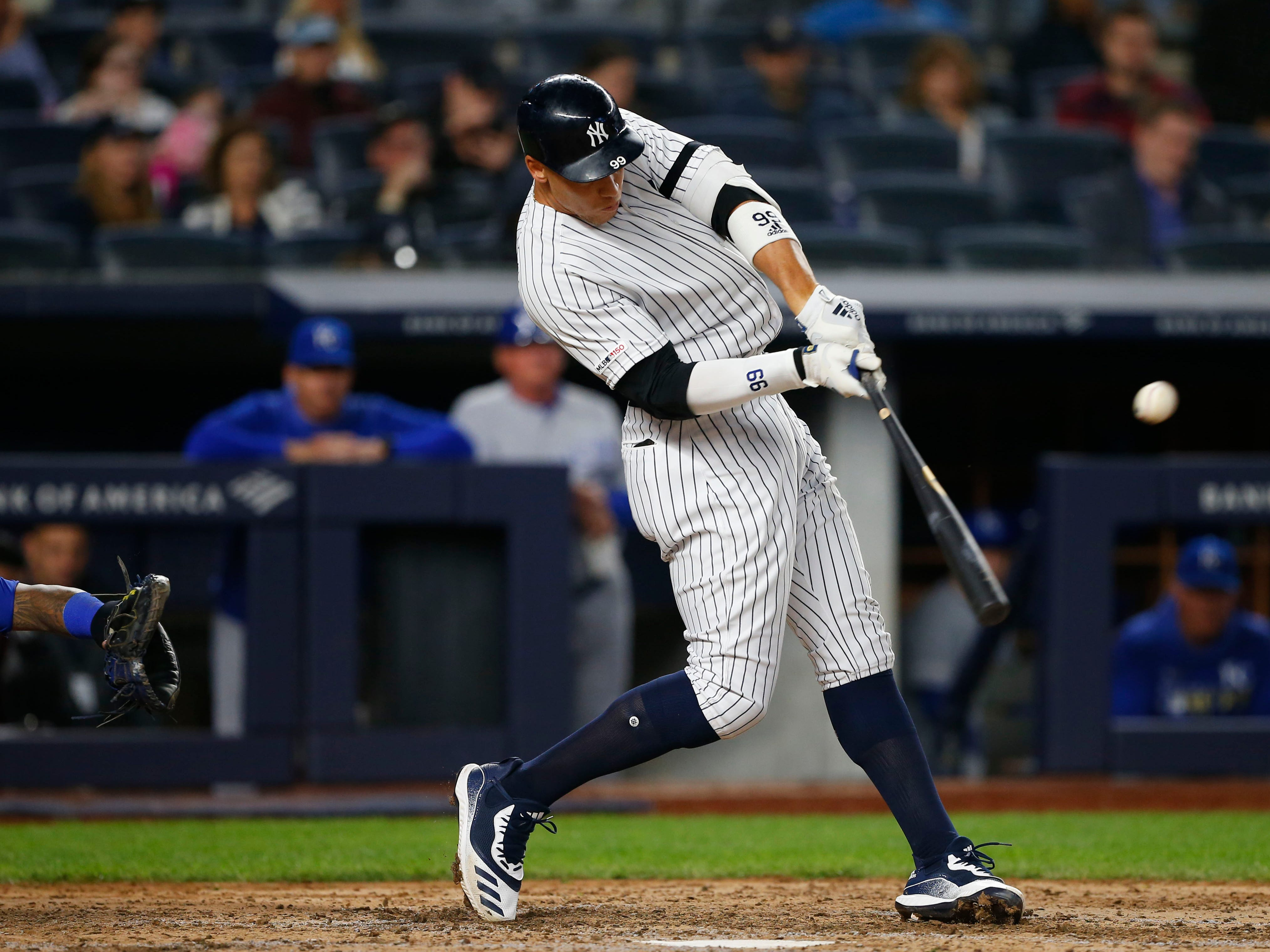 Apr 19, 2019; Bronx, NY, USA;  New York Yankees right fielder Aaron Judge (99) hits a double in the sixth inning against the Kansas City Royals at Yankee Stadium.