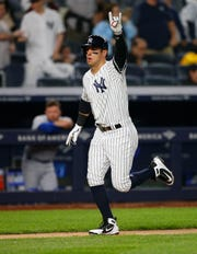 Apr 19, 2019; Bronx, NY, USA;  New York Yankees center fielder Mike Tauchman (39) celebrates as he rounds the bases after a hitting a home run in the fifth inning against the Kansas City Royals at Yankee Stadium.