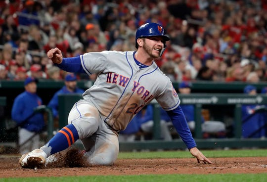 New York Mets' Pete Alonso scores during the fourth inning of a baseball game against the St. Louis Cardinals Friday, April 19, 2019, in St. Louis.