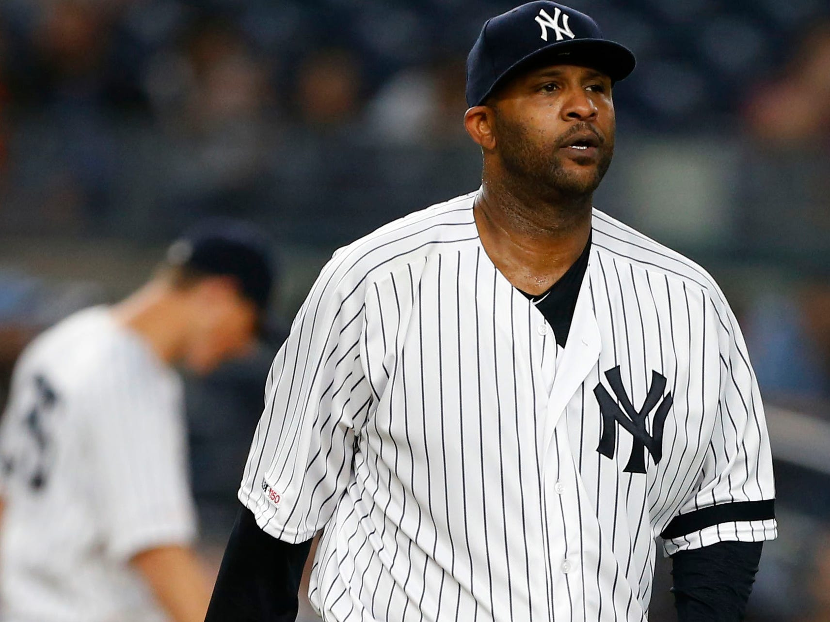 Apr 19, 2019; Bronx, NY, USA;  New York Yankees starting pitcher CC Sabathia (52) reacts after the Kansas City Royals scored a run in the third inning at Yankee Stadium.