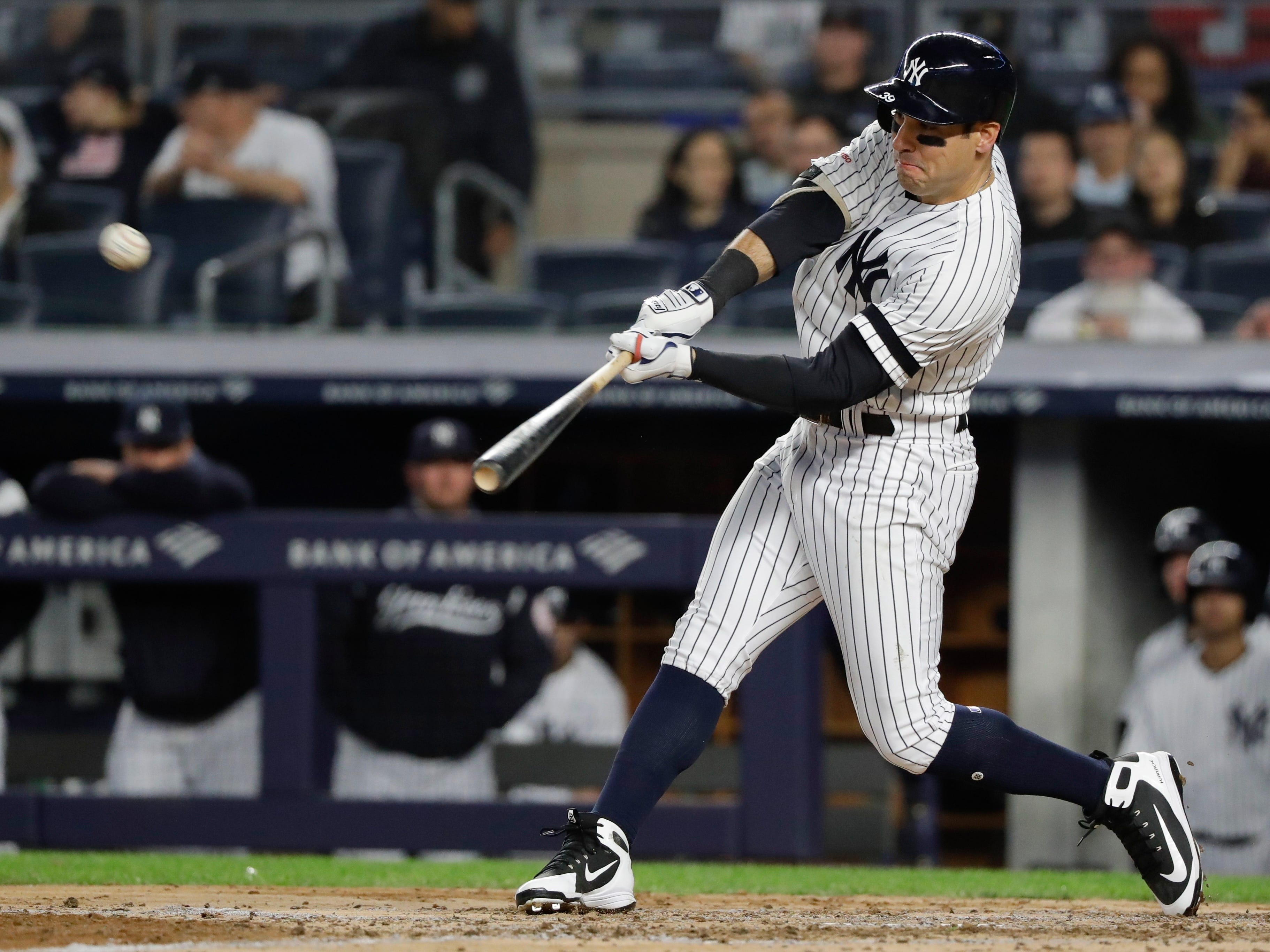 New York Yankees' Mike Tauchman hits a home run during the fifth inning of a  game against the Kansas City Royals, Friday, April 19, 2019, in New York.