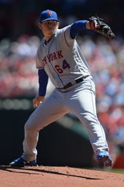 Starting pitcher Chris Flexen of the New York Mets pitches in the first inning against the St. Louis Cardinals at Busch Stadium on April 20, 2019 in St. Louis, Missouri.