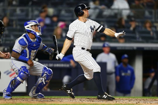 Brett Gardner of the New York Yankees hits a two-run home run in the third inning against the Kansas City Royalsat Yankee Stadium on April 19, 2019 in New York City.