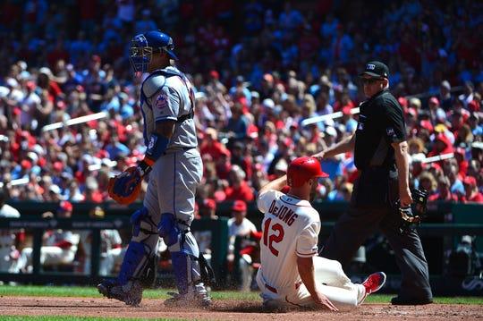 Apr 20, 2019; St. Louis, MO, USA; St. Louis Cardinals shortstop Paul DeJong (12) scores a run past New York Mets catcher Wilson Ramos (40) during the third inning at Busch Stadium.