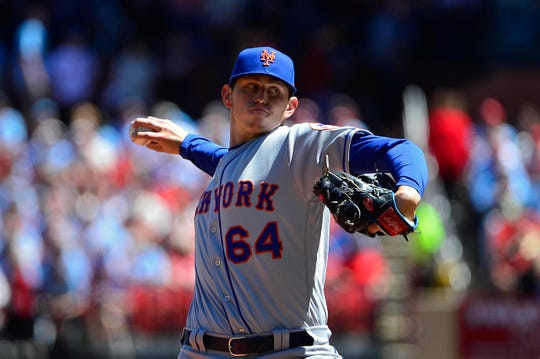 Apr 20, 2019; St. Louis, MO, USA; New York Mets starting pitcher Chris Flexen (64) pitches during the first inning against the St. Louis Cardinals at Busch Stadium.