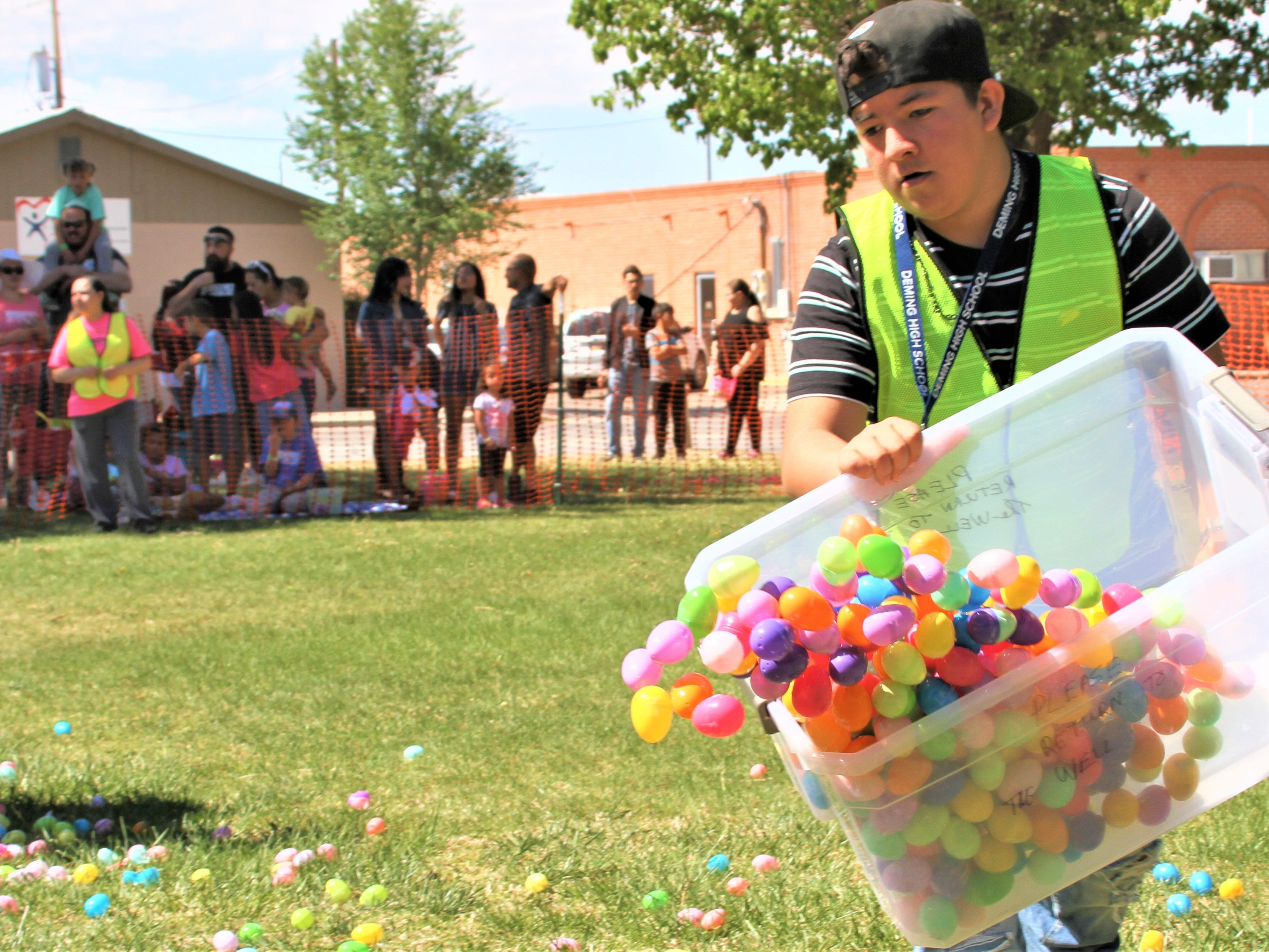 Deming First Assembly of God dumping plastic eggs for next age group.
