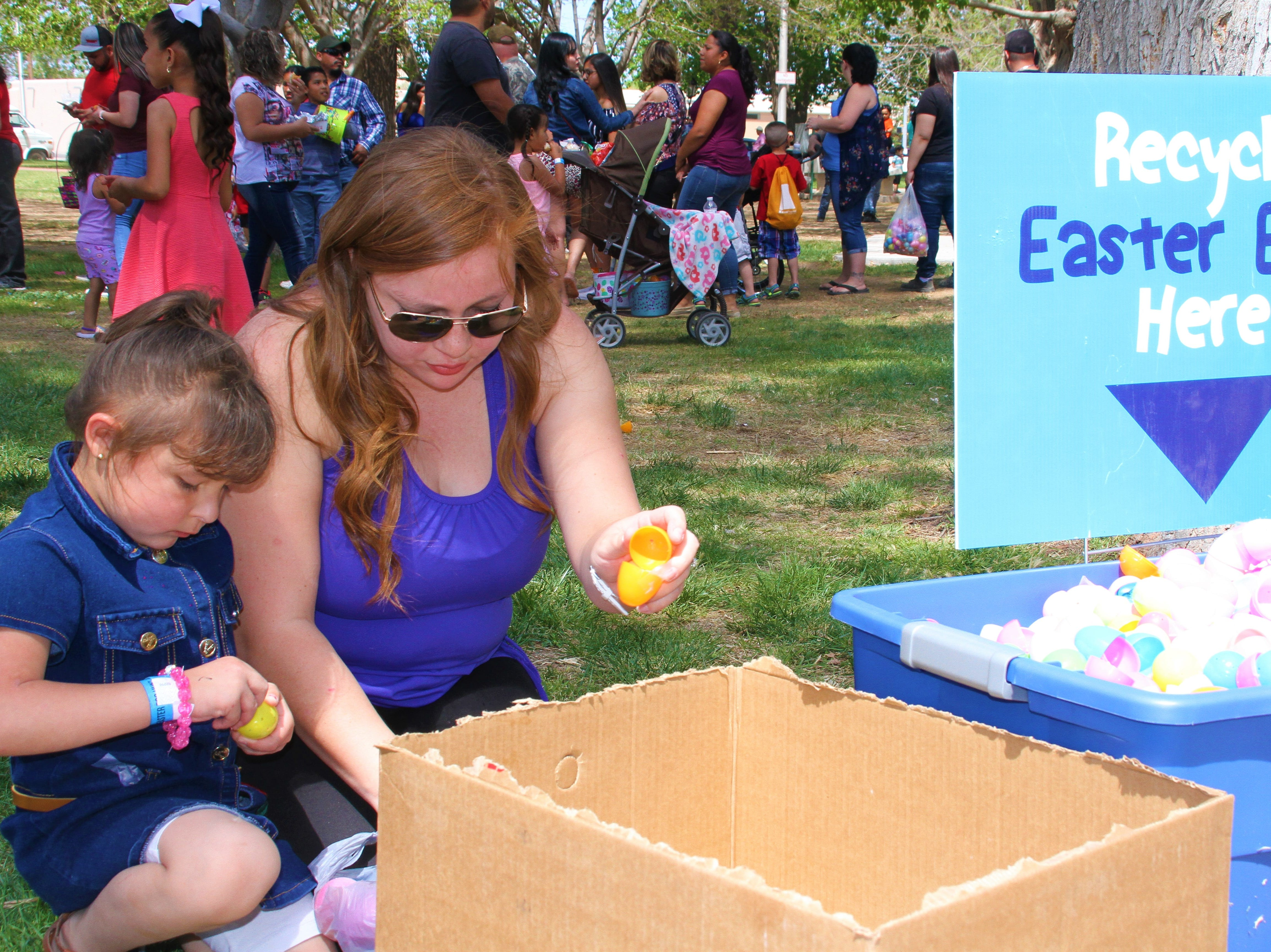 From left, Carly Camerena and mom, Adriana Munoz taking out candy eggs to then recycle them later.