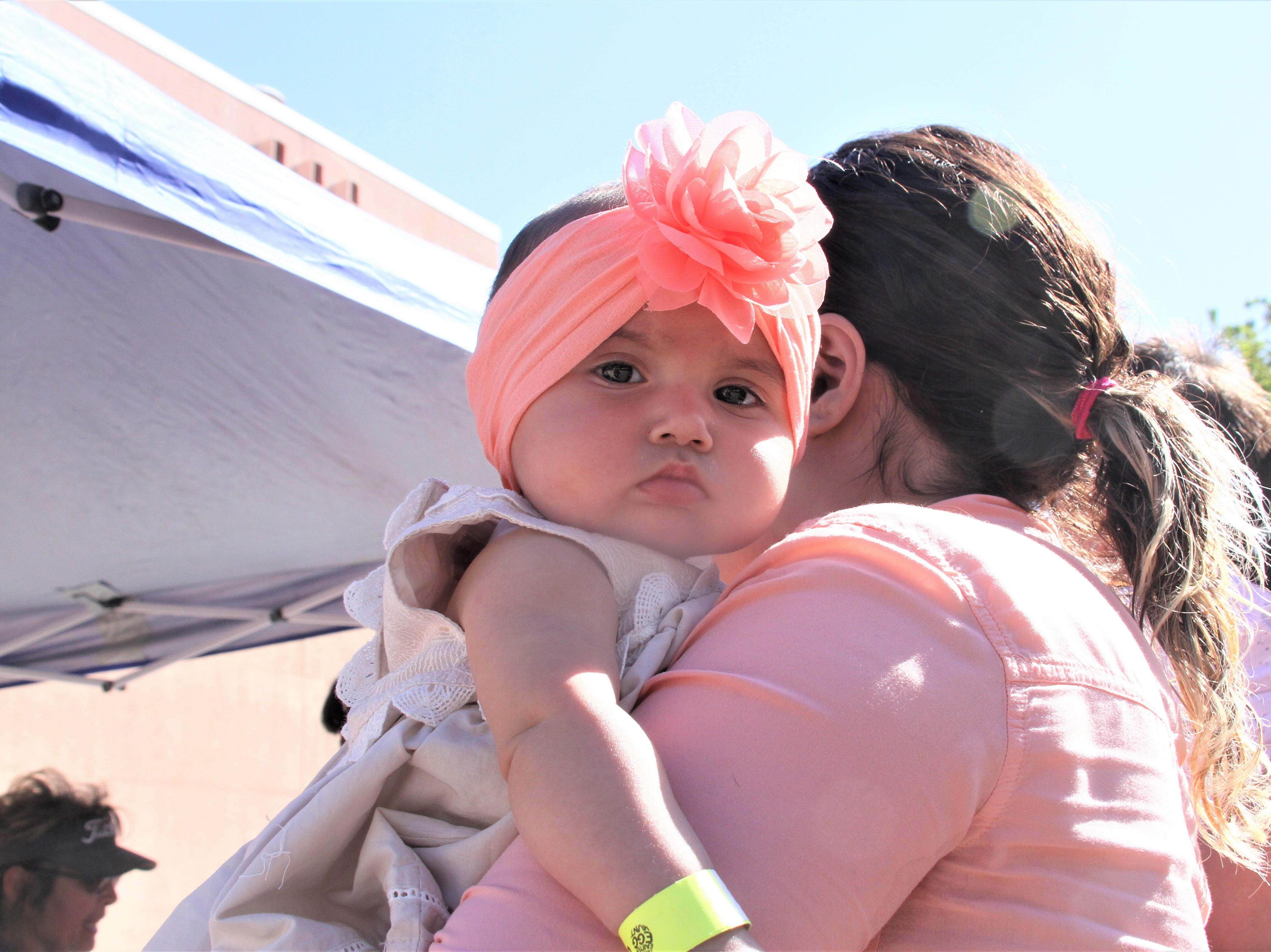 6-month-old Cambria Thompson. Cambria's mother is waiting to register her at the registration booth.