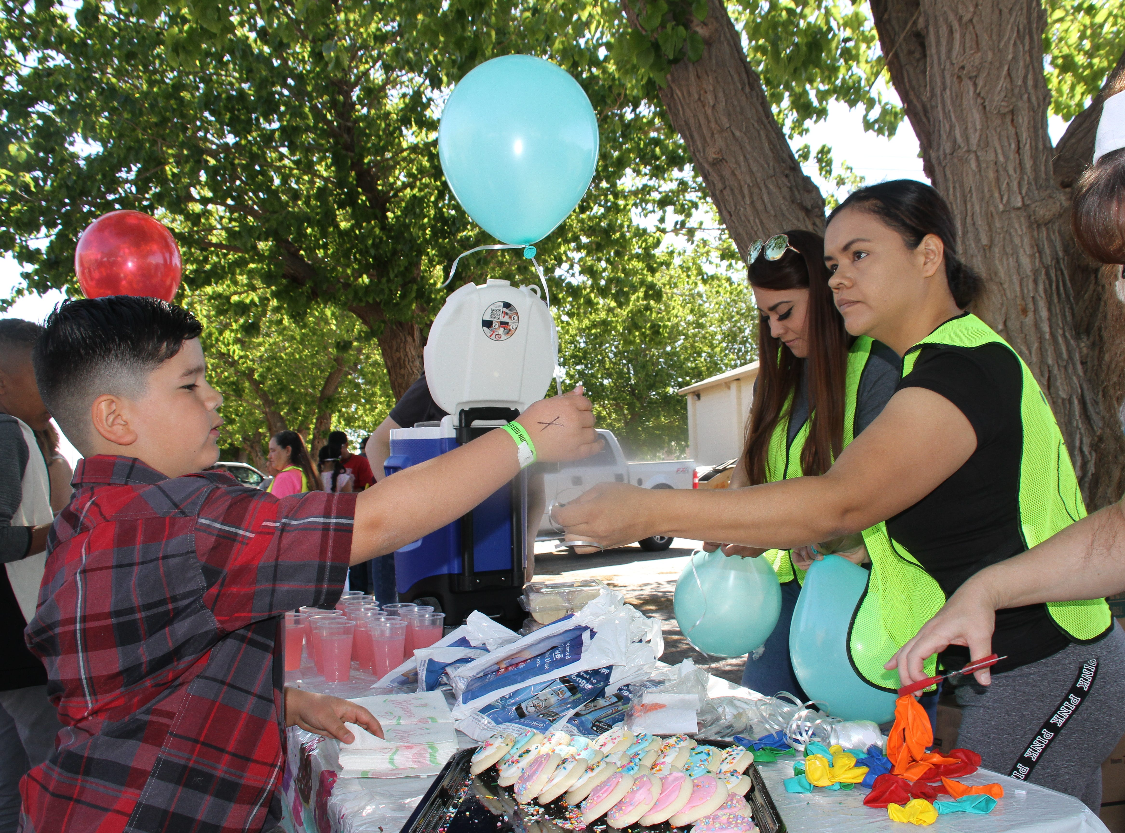Deming Children's Dentistry and Orthodontics offering balloons, lemonade and sugar cookies.