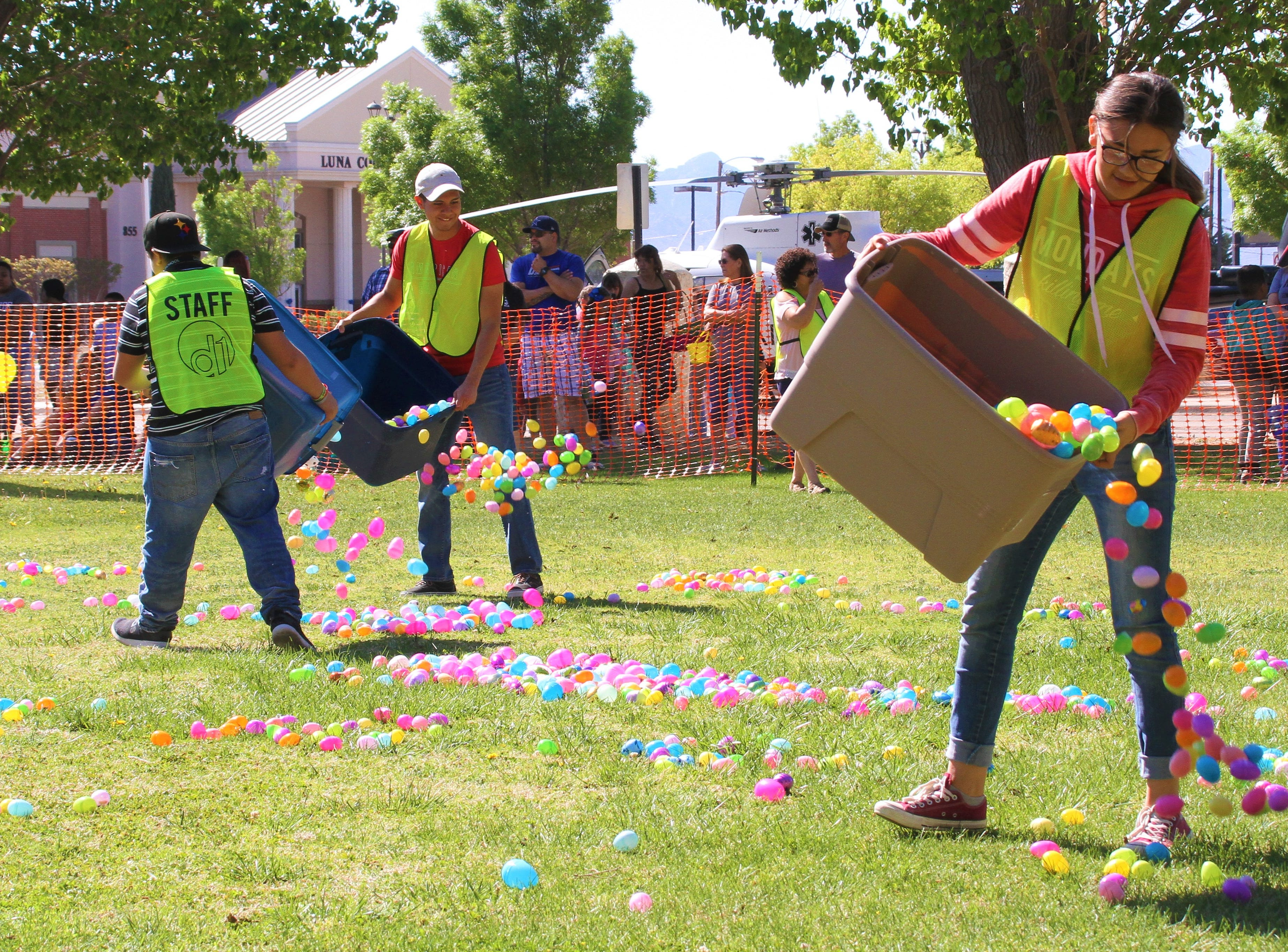 Deming First Assembly of God dumping hundreds of colorful plastic eggs onto the field.
