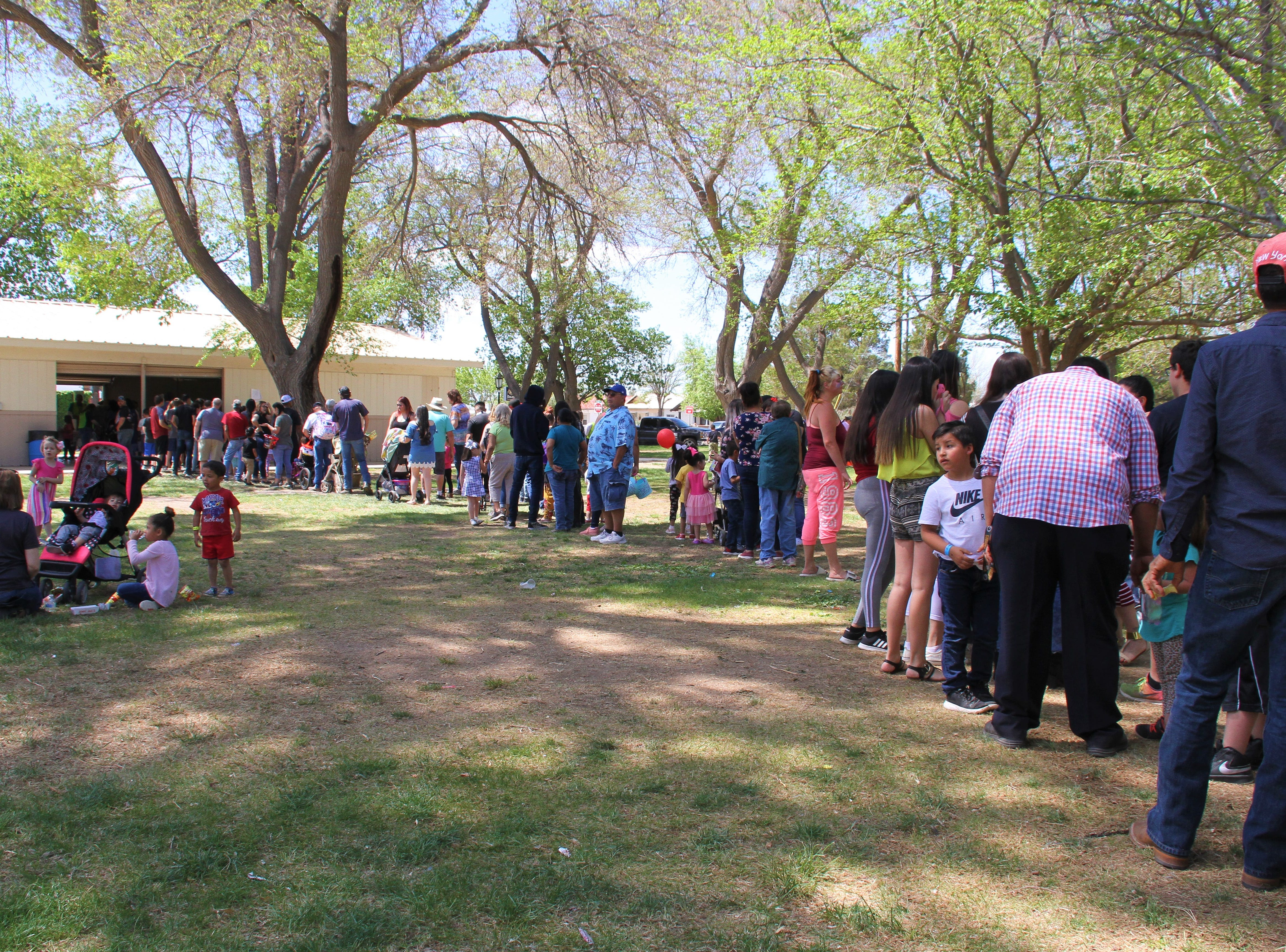 The line to the Luna County Courthouse Park pavilion to get food.