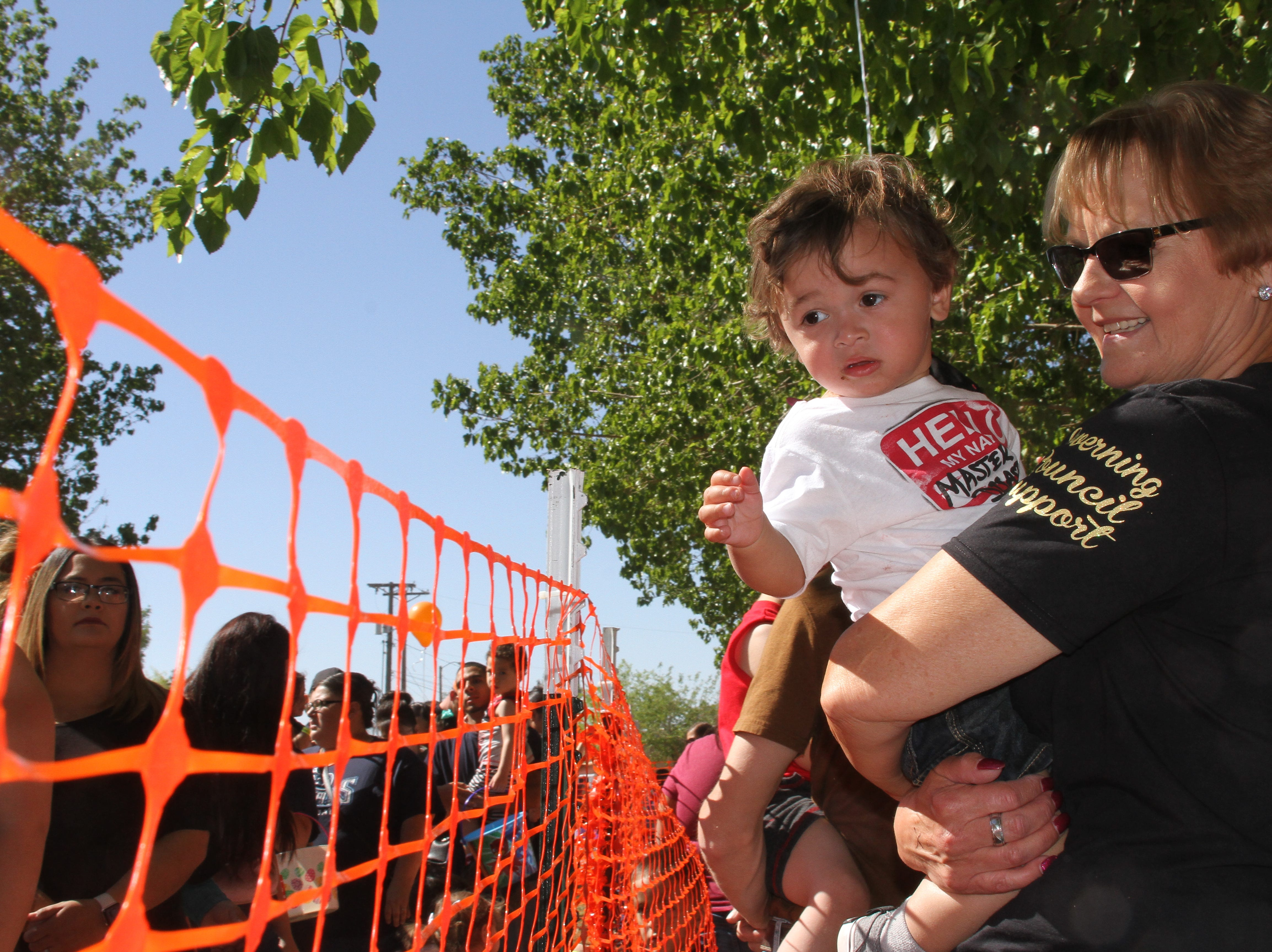 Families line up according to age. Here, 1-year-old Zeiondre Rubalcaba and grandma are waiting to hunt for some eggs.