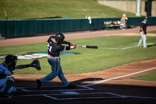 Nick Gonzales swings away during the New Mexico State-Utah Valley matchup in Orem, Utah, on Friday, April 19, 2019. Utah Valley won 10-9.