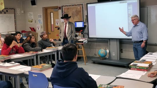 "NMSU faculty members Rory Rank, left, and Steve Nance, right, instruct students at Lynn Middle School, Friday, March 8, 2019, on the ins-and-out of ""Street Law."""