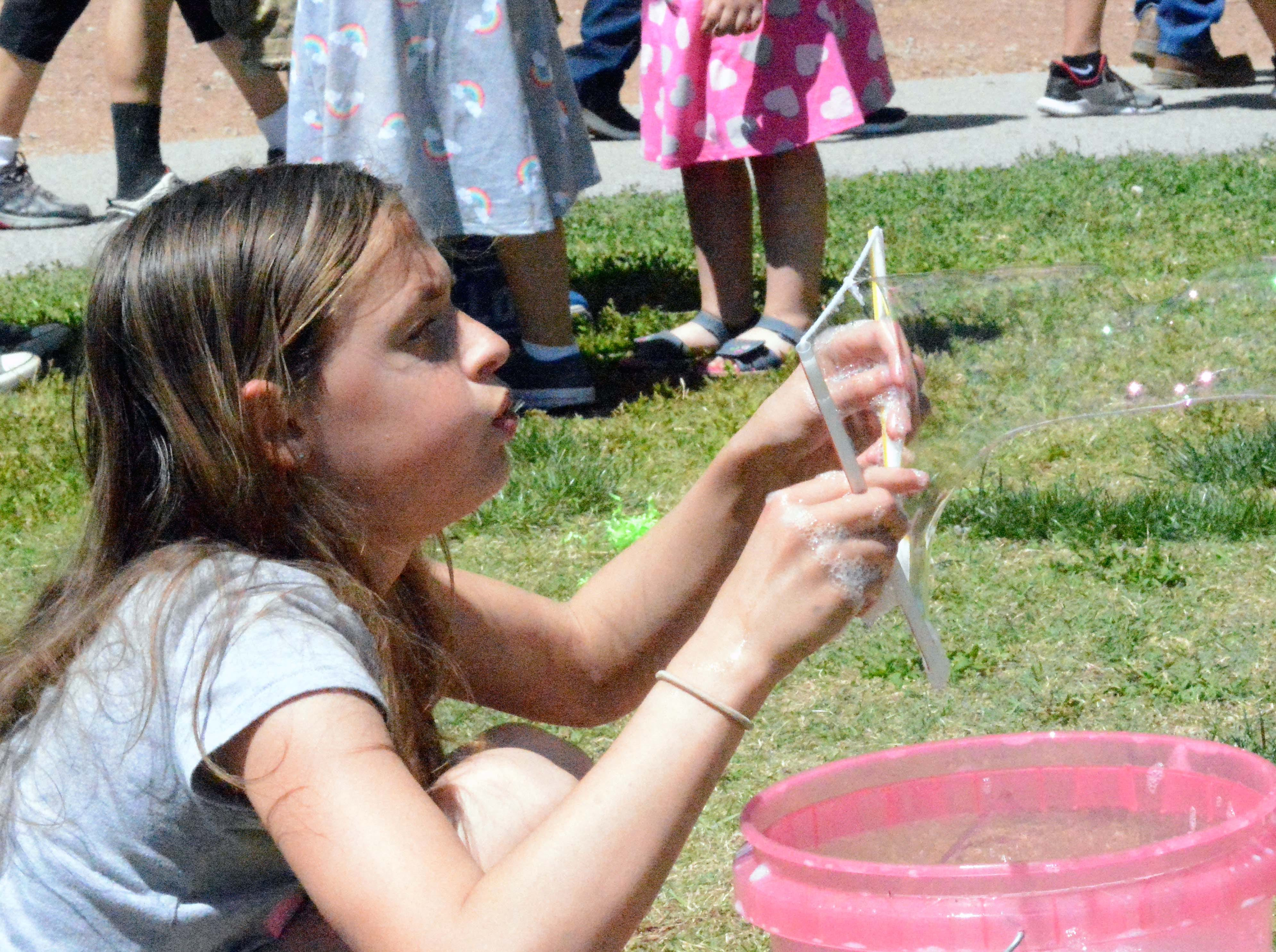 Emilee Francis takes her turn at making  bubbles during SpringFest at Young Park on Saturday, April 20, 2019.