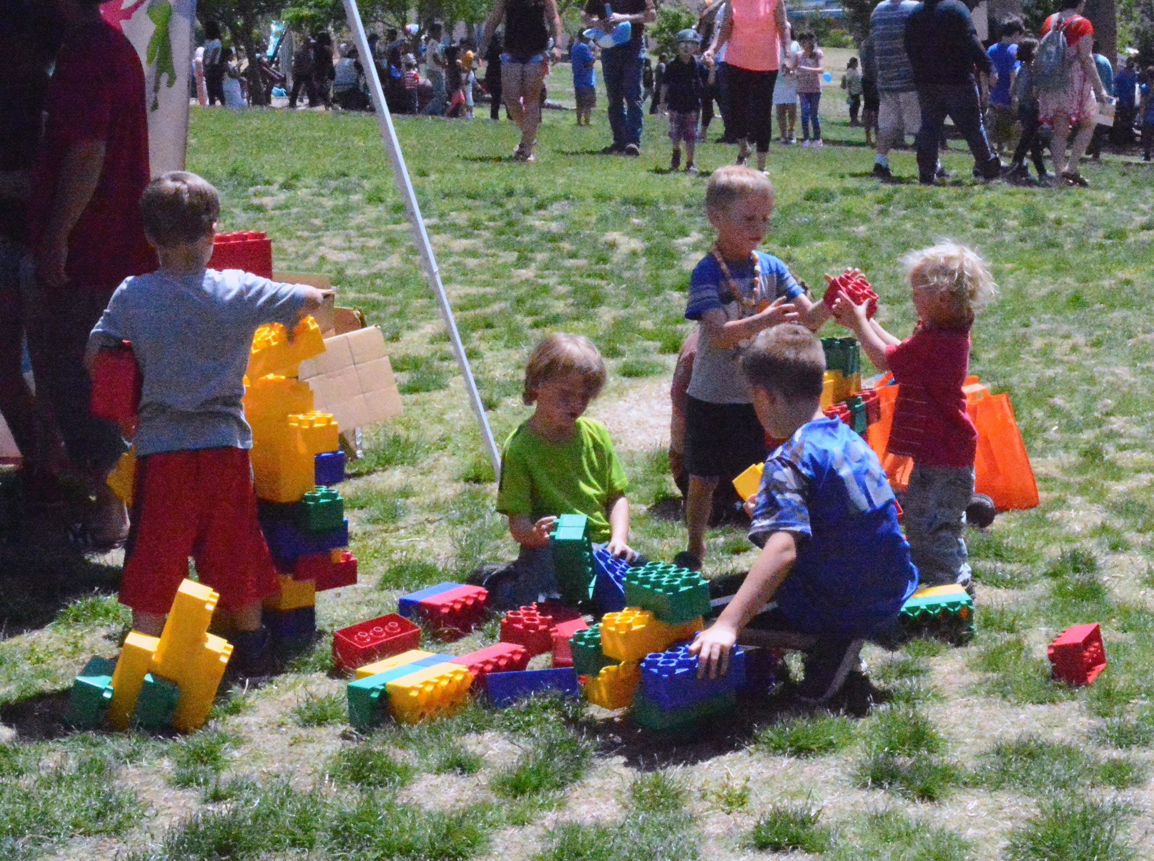 A group of kids enjoy playing with giant-size LEGOs during SpringFest at Young Park on Saturday, April 20, 2019.