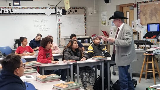 "NMSU adjunct faculty member Rory Rank teaches students at Lynn Middle School ""Street Law"" Friday, March 8, 2019, during a class being taught every Friday this past semester at Lynn Middle School."