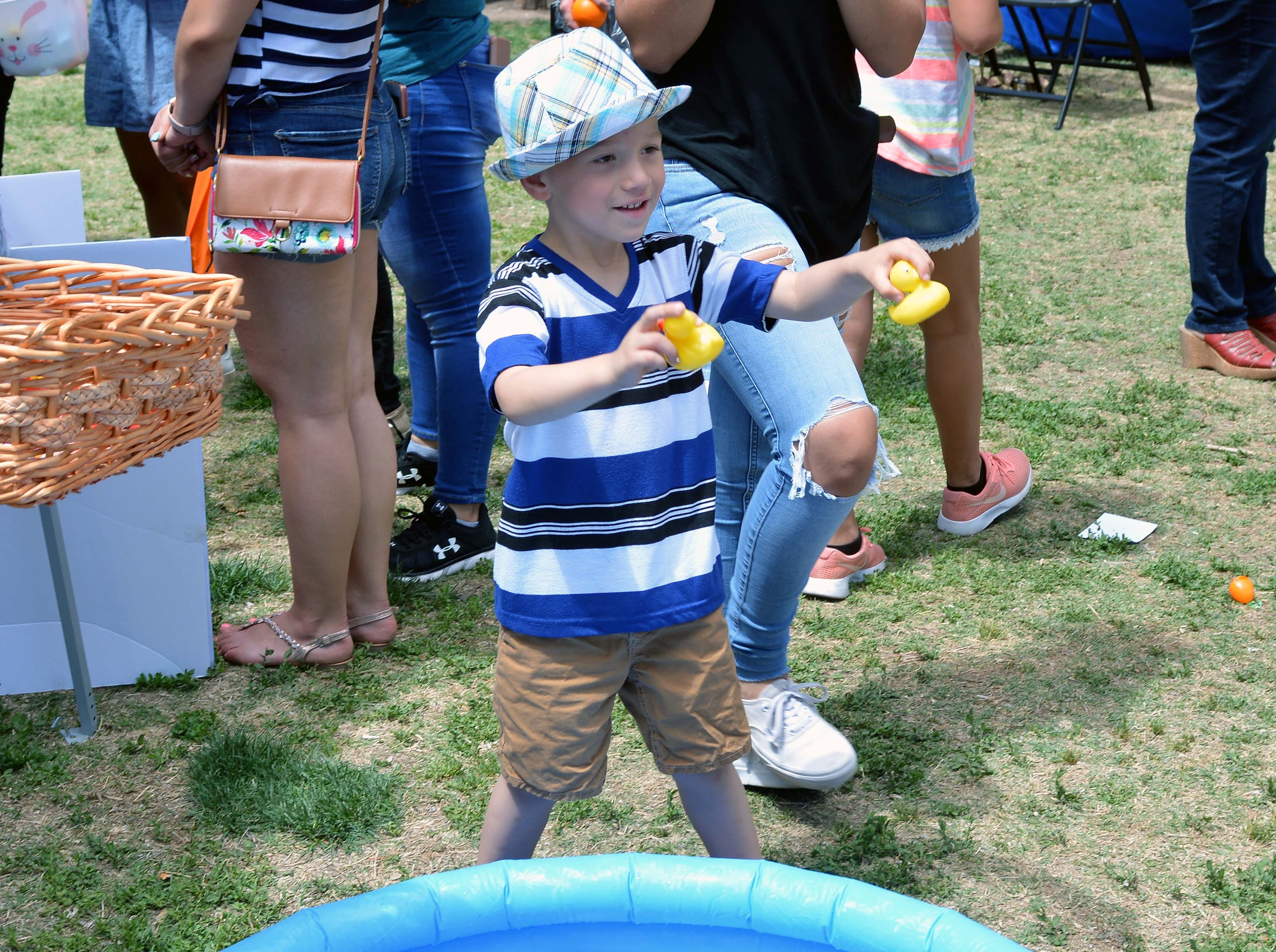 Caleb Valdiviezo, 4, finds a pair of matching ducks and wins a prize during SpringFest at Young Park on Saturday, April 20, 2019.