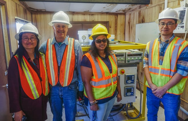 From left: New Mexico State University Environmental Engineering Professor Pei Xu, Program Specialist David Johnson, Ph.D. student Chathurika Bandara and Postdoctoral Researcher Xuesong Xu are monitoring the treatment process they developed to render municipal wastewater into drinking water.
